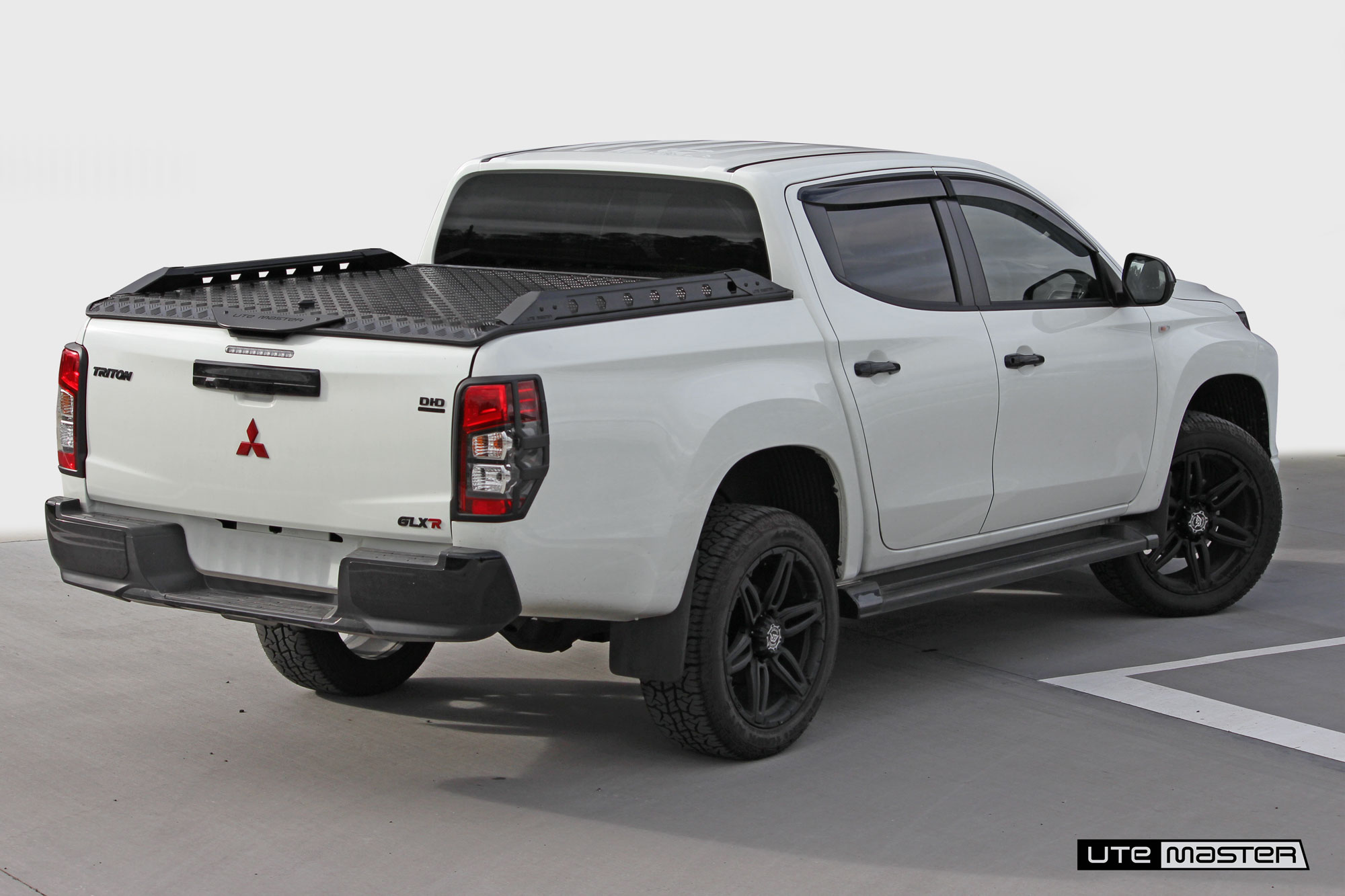 MitsubishiTriton Hard Lid_Black and White_Load-Lid by Utemaster Roller Shutter and Tonneau Cover Alternative